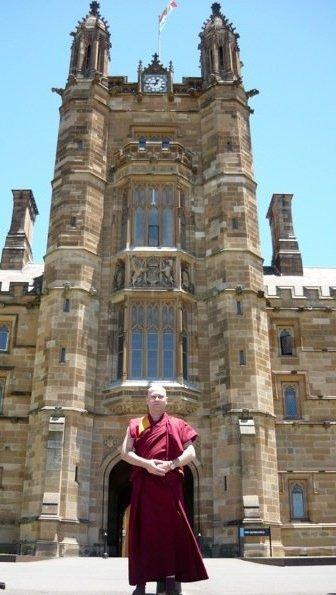 Clarke standing outside Sydney uni